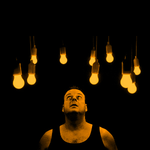 Man staring at light bulbs.